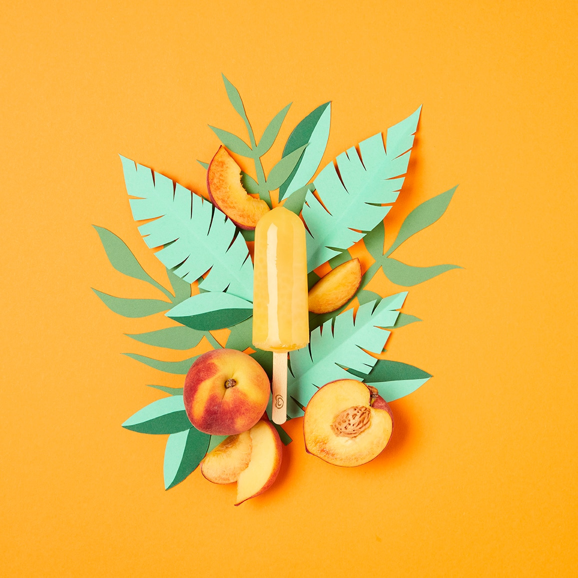 Ice lolly with peaches and leaves